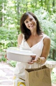 woman bringing casserole and meal - post surgical resources