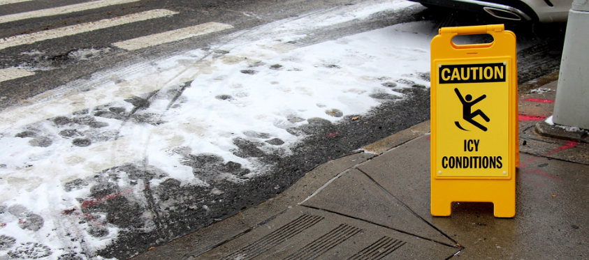 icy sidewalk-yellow caution sign-fall prevention-baby its cold outside