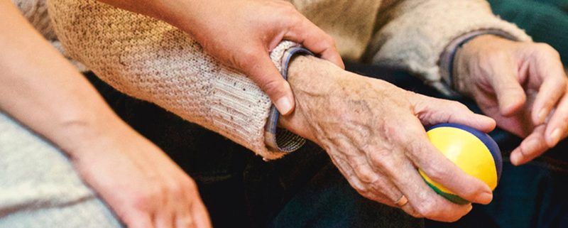 Senior being reassured by caregiver
